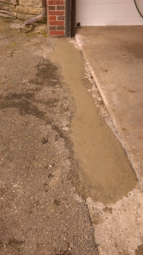 After home repair of residence driveway concrete